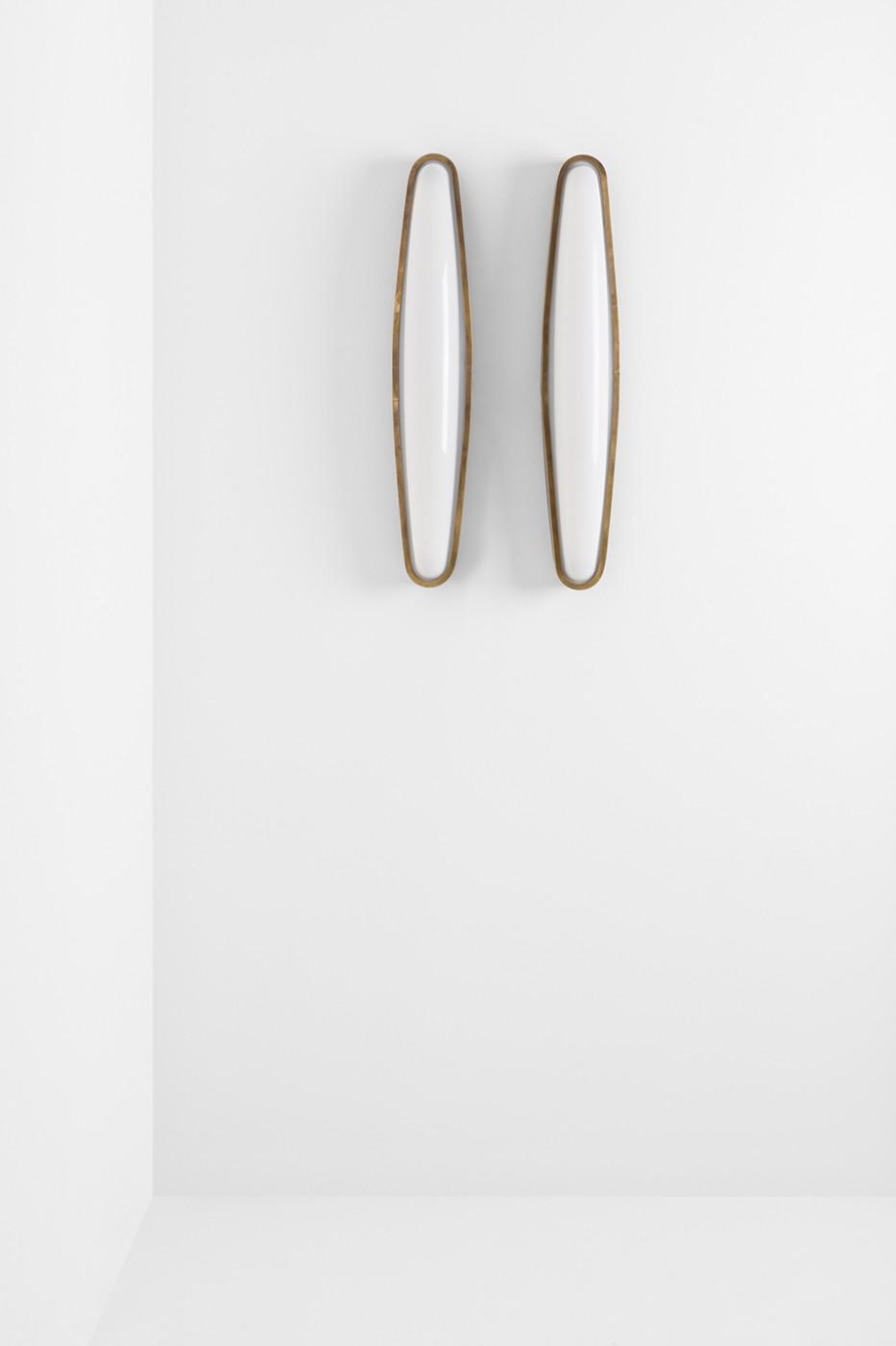 Applique metal applique tuyau by serge mouille with for Design seminterrato non finito